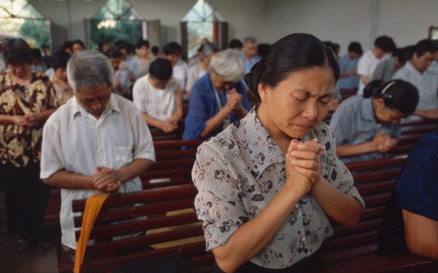 Prayer in an Asian church